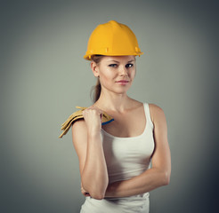 Female student constructor. Young girl wearing protective helmet