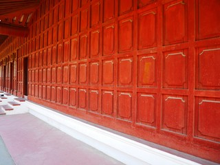 Red old wooden wall and door at Mandalay Palace