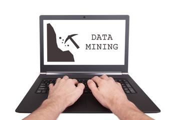 Man working on laptop, data mining