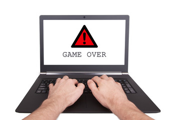 Man working on laptop, game over