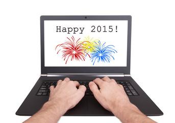 Man working on laptop, happy 2015