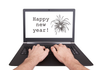 Man working on laptop, happy new year