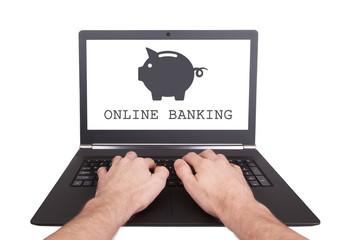 Man working on laptop, online banking