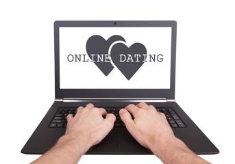 Man working on laptop, online dating
