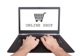 Man working on laptop, online shop