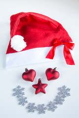 Face made of Santa Claus hat and ornaments