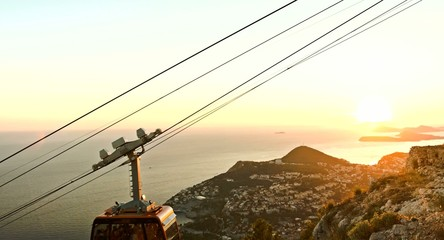 Beautiful View Of Old City Dubrovnik Cable Car Passing By Sunset