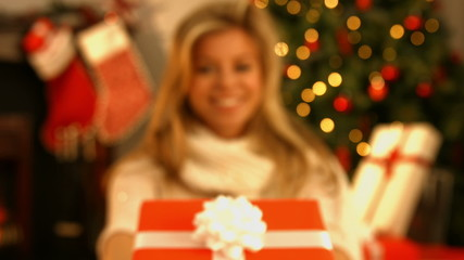Pretty blonde showing a gift