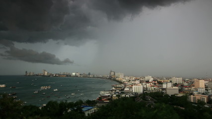 Storm clouds and rain over Sea beach city , time lapse.