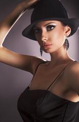Elegant brown eyes woman with black hat.