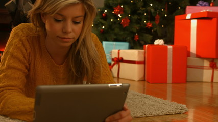 Pretty blonde using her tablet pc