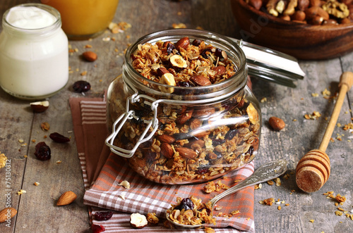 Granola in a glass jar. - 75130812
