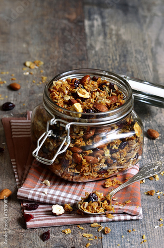 Granola in a glass jar. - 75130817
