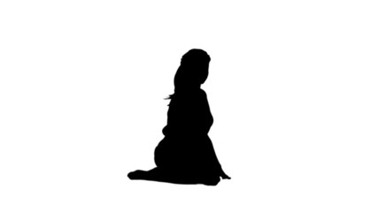Silhouette of woman stretching her legs
