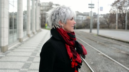 middle aged woman lost in city - urban street