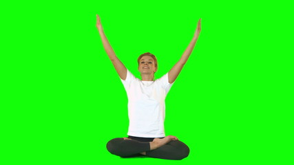 Calm woman sitting on floor in lotus position