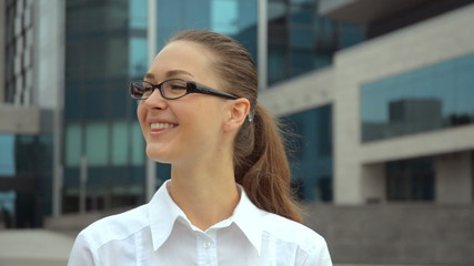 Beautiful young business woman in glasses smiling