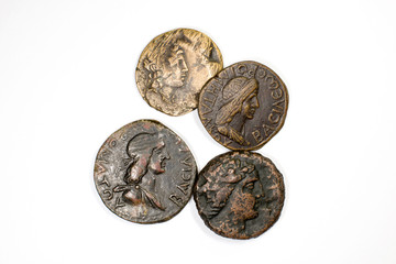 Four old coins on white background