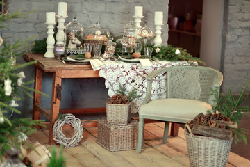 in a room with a beautiful Christmas table decorations, chair an