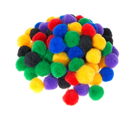 Group of craft pompoms on a white background