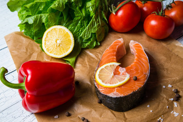 Fresh salmon steak with herbs and vegetables