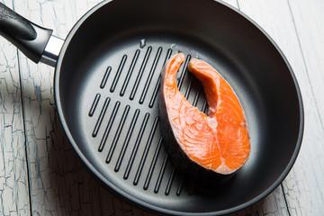 Fresh salmon steak on the grill pan