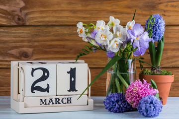 First day of spring flowers and calendar