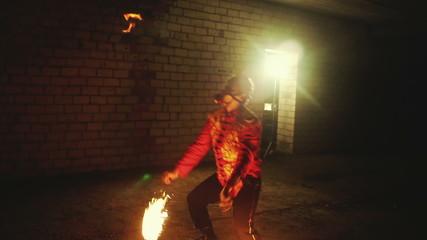 a man  make a fire performance