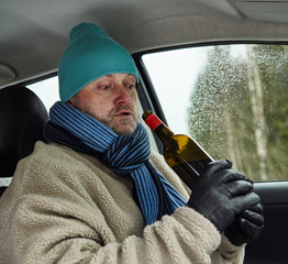 Driver and wine bottle