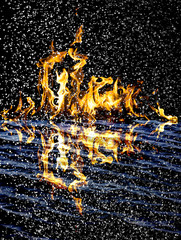 snow on the fire background with reflection on water