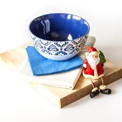 Ceramic kitchen ware of various colors for laying of a New Year'