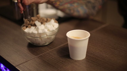 Sugar and a cup of fresh coffee.