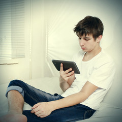 Tired Teenager with Tablet