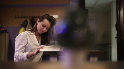 Girl student in a cafe reading a book