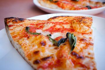 Traditional slise of pizza margarita