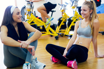 Young people resting after class in the gym.