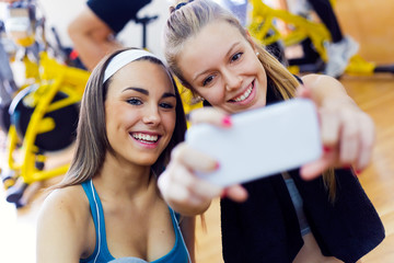 Young women taking a selfie in the gym.