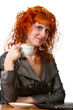 woman holding a cup of coffee