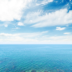 clouds in blue sky over sea