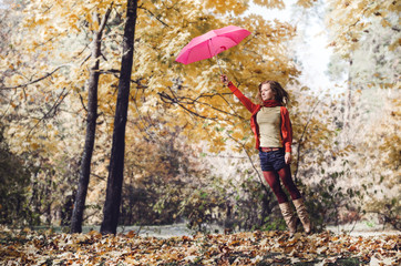 Woman jump with Umbrella