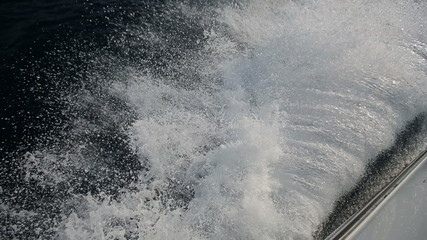 Sea spray from the yacht