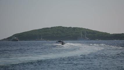 Motor boat sailing on the Adriatic Sea in Croatia