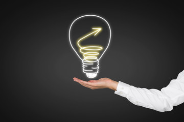 hand holding drawing lightbulb