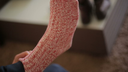 The man wears knitted socks