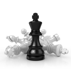 Black king standing over fallen black chess pieces, isolated