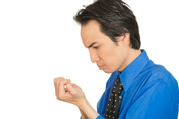 OCD man looking at hands nails obsessing about cleanliness germs