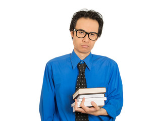 worried stressed unhappy student with glasses holding books
