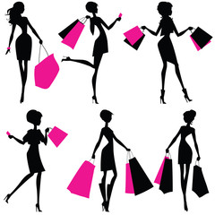Silhouettes of women with shopping bags