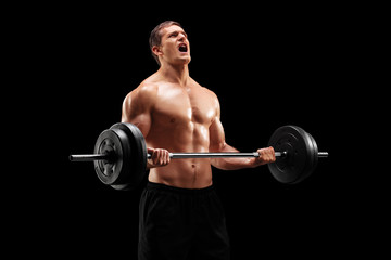 Muscular bodybuilder lifting  with weights