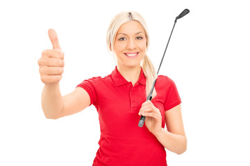 Smiling female golfer giving thumb up